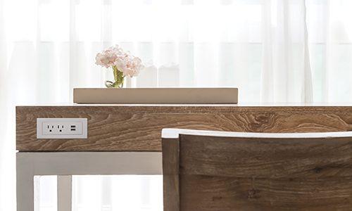 wooden desk beside white ruffle curtain